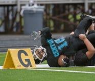 Mancanza di obiettivo di gioco del calcio dai pollici Fotografia Stock