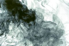 Mancha blanca /negra blanca del humo en negro fotos de archivo libres de regalías