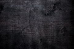 Mancha coloreada fondo de madera negro del extracto de la madera contrachapada fotografía de archivo