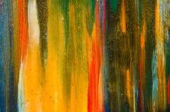 Manchas amarelas longas da pintura da aquarela na lona Fotos de Stock