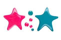 Manchas ou gotejamentos do verniz para as unhas sob a forma da estrela foto de stock royalty free