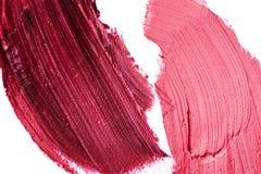 Manchas púrpuras y rosadas del lápiz labial Imagenes de archivo