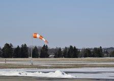 Manche à air à l'aéroport en hiver Photographie stock libre de droits