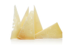 Manchego cheese. Some slices of manchego cheese on a white background royalty free stock photos