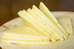Manchego cheese cut into slices Royalty Free Stock Photography