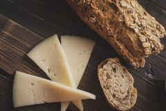 Manchego cheese and multigrain bread royalty free stock photos