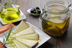 Manchego cheese in olive oil Royalty Free Stock Photo