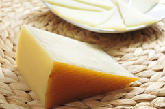 Manchego cheese from Spain. Closeup of a piece and some slices of manchego cheese from Spain Stock Images