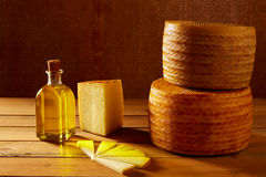 Manchego cheese from Spain in wooden table Royalty Free Stock Photos