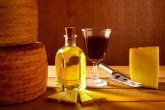 Manchego cheese from Spain in wooden table Royalty Free Stock Images