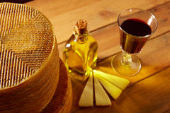 Manchego cheese from Spain in wooden table Stock Image