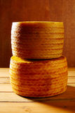 Manchego cheese from Spain in wooden table Royalty Free Stock Photo