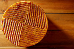 Manchego cheese from Spain in wooden table Royalty Free Stock Image