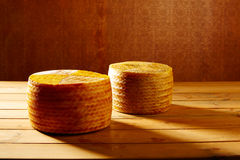 Manchego cheese from Spain in wooden table Stock Photos