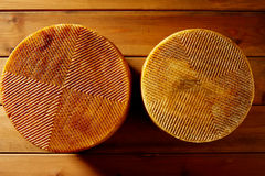 Manchego cheese from Spain in wooden table Royalty Free Stock Photography