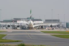 Manchester airport. Busy Turn around of aircraft at Manchester airport Stock Photos