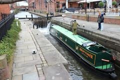 Manchester canal lock. MANCHESTER, UK - APRIL 21, 2013: People visit Castlefield canal area in Manchester, UK. Castlefield is an Urban Heritage Park since 1982 Stock Photo