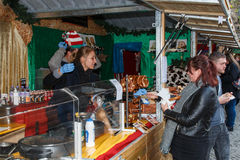 Manchester Christmas market stall selling German food Stock Photo