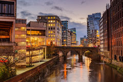Manchester city centre, UK. Modern apartments on both side of river Irwell passing through Manchester city center, UK