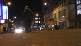 Manchester city at night people crossing street. MANCHESTER, UNITED KINGDOM - JANUARY 14, 2016: Low angle shot of people crossing Oxford street in Manchester stock footage
