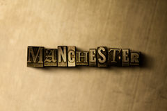 MANCHESTER - close-up of grungy vintage typeset word on metal backdrop Royalty Free Stock Photo