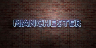 MANCHESTER - fluorescent Neon tube Sign on brickwork - Front view - 3D rendered royalty free stock picture Royalty Free Stock Image
