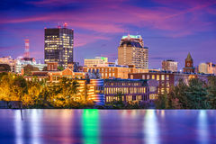 Manchester, New Hampshire. USA Skyline on the Merrimack River royalty free stock photos