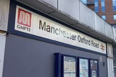Manchester, R-U - 10 mai 2017 : Extérieur de gare ferroviaire de route d'Oxford à Manchester Photo libre de droits