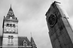 Manchester Town Hall 2. Black and white image of Manchester`s town hall with a war memorial to the right of frame Stock Image