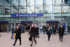 Piccadilly Station, Manchester. MANCHESTER, UK - APRIL 23, 2013: Travelers hurry at Piccadilly Station in Manchester, UK. More than 18 million passengers used royalty free stock image