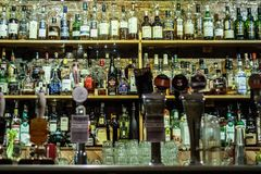 Liquors and spirits bottles in a pub royalty free stock images