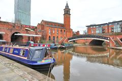 Manchester, UK. Manchester - city in North West England (UK). Castlefield district, waterway canal area with a narrowboat stock photography