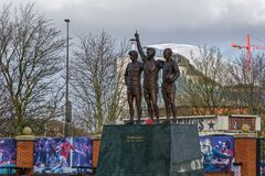 Manchester, UK Manchester United Holy Trinity statue outside Old Trafford stadium.