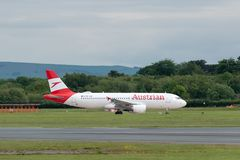 MANCHESTER UK, 30 MAY 2019: Austrian Airlines Airbus A320 flight OS464 to Vienna taxies onto Runway 28L at Manchester Airport.  stock photography