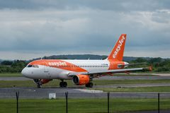 MANCHESTER UK, 30 MAY 2019: Easyjet Airbus A320 flight U21950 from Geneva turns off Runway 28R at Manchester Airport after landing.  royalty free stock photos