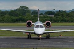 MANCHESTER UK, 30 MAY 2019: Loganair Embraer ERJ-145EP flight LM595 from Inverness turns off Runway 28R at Manchester Airport. After landing stock image