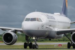 MANCHESTER UK, 30 MAY 2019: Lufthansa Airbus A319 flight LH938 from Frankfurt turns off runway 23R at Manchaester Airport after. Landing stock images