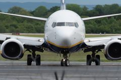 MANCHESTER UK, 30 MAY 2019: Ryanair Boeing 737 flight FR3127 from Marrakech turns off runway 23R at Manchaester Airport after. Landing stock photography