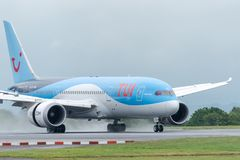MANCHESTER UK, 30 MAY 2019: TUI Boeing 787-8 Dreamliner flight BY2429 from Dubrovnik lands on runway 23R at Manchaester Airport. Reverse engine thrust kicks up royalty free stock images