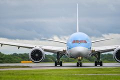 MANCHESTER UK, 30 MAY 2019: TUI Boeing 787-8 Dreamliner flight BY2429 from Dubrovnik taxies off runway 23R at Manchaester Airport. After landing royalty free stock images