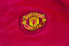 Manchester United emblem. On football jersey royalty free stock photo