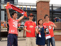 Manchester United fans at the stadium. ANN ARBOR, MI - AUGUST 2:  Manchester United fans get their pictures taken outside Michigan Stadium at the International Stock Image