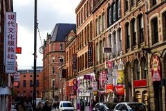 Chinatown street Manchester. MANCHESTER, UNITED KINGDOM - 5 March, 2016: A busy street with Chinese restaurants and stores in the Chinatown part of Manchester Royalty Free Stock Photo