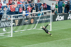 Manchester United's keeper trying to save a penalty shot. Manchester United's reserve keeper, attempting to save a penalty shot. Tour 2014, Guinness stock photography