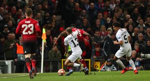 Manchester United v Paris Saint-Germain - UEFA Champions League Round of 16: First Leg. MANCHESTER, ENGLAND - FEBRUARY 12 2019: Dani Alves of PSG mould Paul royalty free stock photos