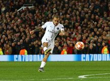 Manchester United v Paris Saint-Germain - UEFA Champions League Round of 16: First Leg. MANCHESTER, ENGLAND - FEBRUARY 12 2019: Dani Alves of PSG takes a shot royalty free stock photos