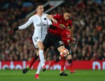 Manchester United v Paris Saint-Germain - UEFA Champions League Round of 16: First Leg. MANCHESTER, ENGLAND - FEBRUARY 12 2019: Julian Draxler of PSG and Nemanja royalty free stock photo