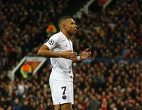 Manchester United v Paris Saint-Germain - UEFA Champions League Round of 16: First Leg. MANCHESTER, ENGLAND - FEBRUARY 12 2019: Kylian Mbappe of PSG celebrates stock photography