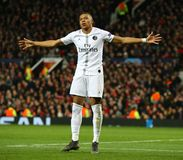 Manchester United v Paris Saint-Germain - UEFA Champions League Round of 16: First Leg. MANCHESTER, ENGLAND - FEBRUARY 12 2019: Kylian Mbappe of PSG celebrates stock image