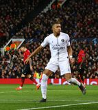 Manchester United v Paris Saint-Germain - UEFA Champions League Round of 16: First Leg. MANCHESTER, ENGLAND - FEBRUARY 12 2019: Kylian Mbappe of PSG celebrates stock photo